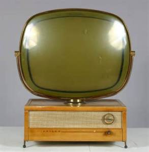 If I had a splendid vintage  telly like this, I might be persuaded to watch it, a little...